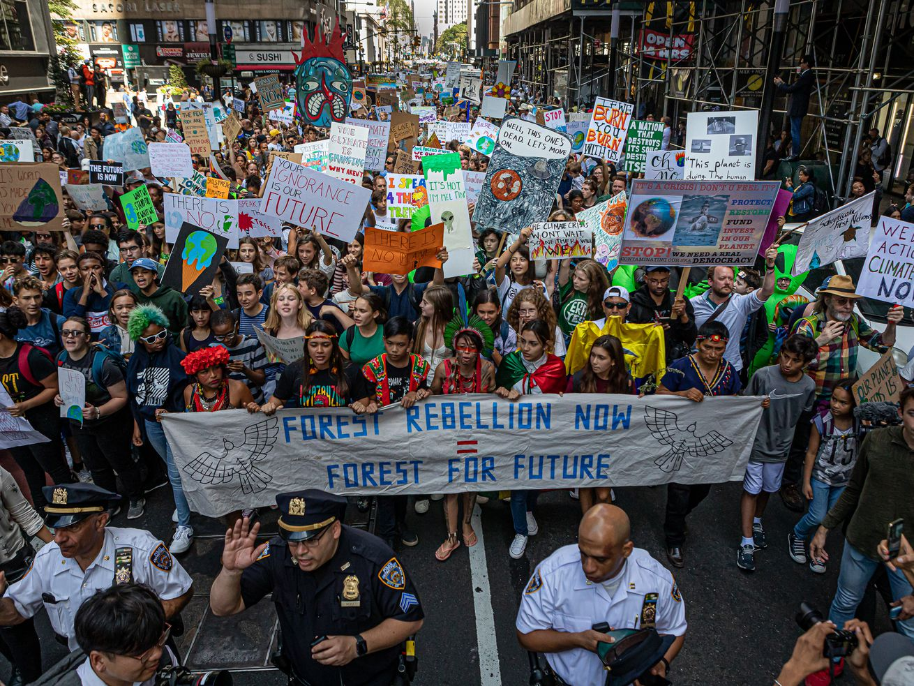 A crowd of protesters fill a New York City street.