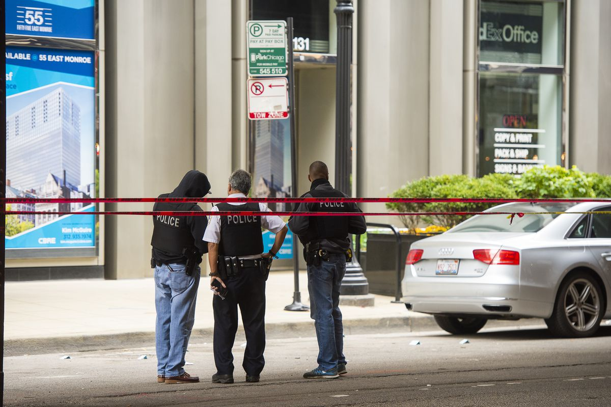 Chicago police investigate a person shot Saturday afternoon near Adams and Wabash in the Loop. | Tyler LaRiviere/Sun-Times