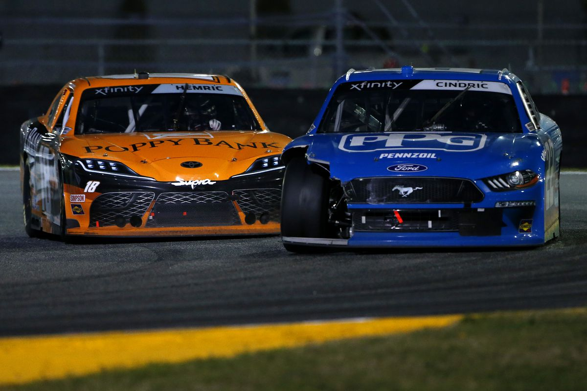 Austin Cindric, driver of the #22 PPG Ford, and Daniel Hemric, driver of the #18 Poppy Bank Toyota, race during the NASCAR Xfinity Super Start Batteries 188 At Daytona Presented by O'Reilly at Daytona International Speedway on February 20, 2021 in Daytona Beach, Florida.