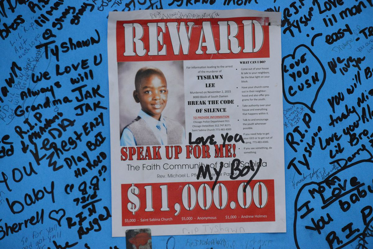"""<small><strong>Pierre Stokes, Tyshawn Lee's father wrote """"Love You My Boy"""" at the memorial where his son was killed. 