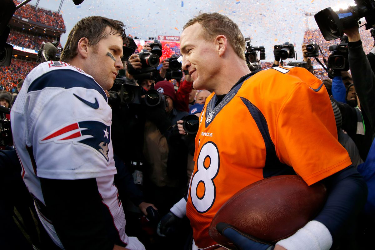 Peyton Manning of the Denver Broncos and Tom Brady of the New England Patriots speak after the AFC Championship game at Sports Authority Field at Mile High on January 24, 2016 in Denver, Colorado.