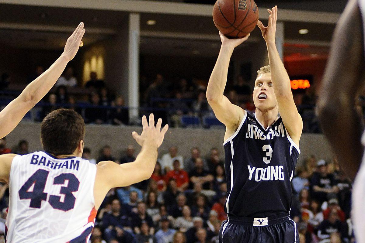 BYU's Tyler Haws (3) looks to complete a jumper against Gonzaga's Drew Barham (43).