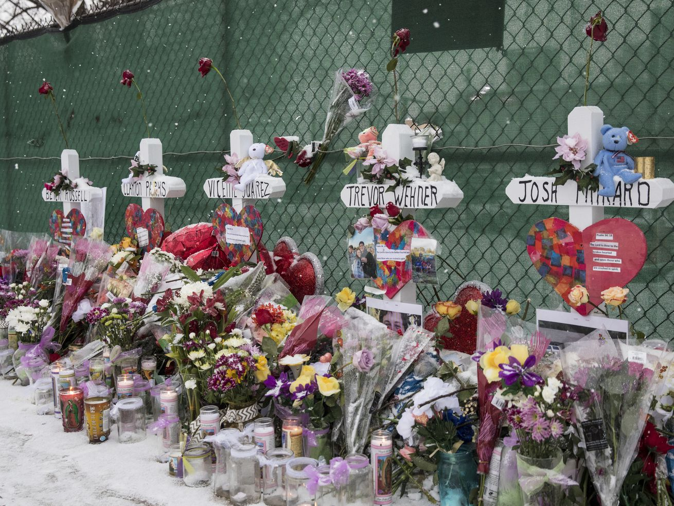 Memorials sit outside the Henry Pratt Company in Aurora on Feb. 17,. Five people were killed in a mass shooting at the company.