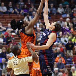 Washington Mystics' Stefanie Dolson (31) and Kelsey Bone (3) during the jump ball to start overtime.