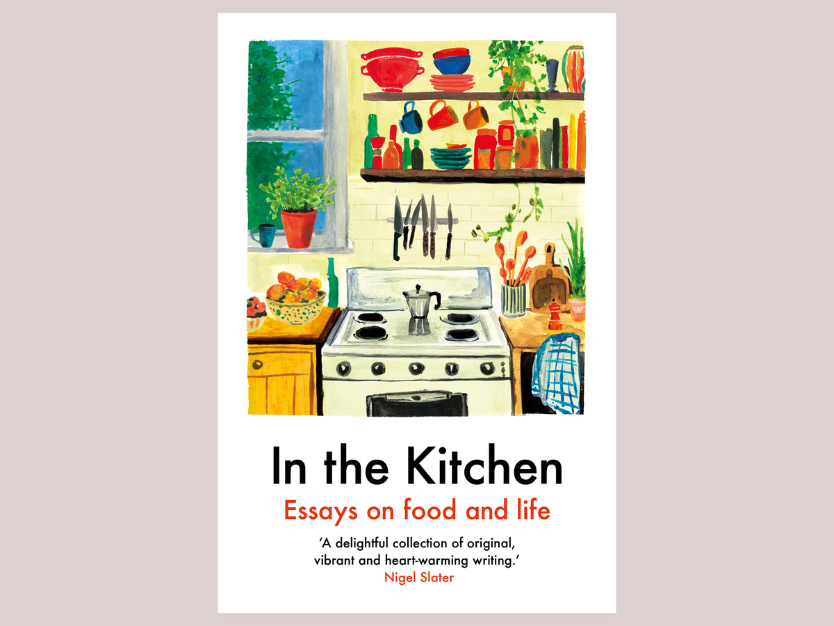The front cover of In the Kitchen: Essays on Food and Life, with a painting of a kitchen with a gas hob, moka pot coffee maker, and plants and cookbooks on shelves above. There is a window off left with a view to a garden