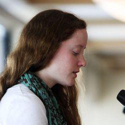 Manon Gilmore recites her Holocaust Literary Contest winning poem during a Utah Holocaust Memorial Commemoration at the Jewish Community Center in Salt Lake City, Thursday, April 19, 2012.