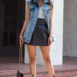 "Sheryl of <a href=""http://www.walkinwonderland.com"">Walk in Wonderland</a> is wearing a <a href=""https://www.againapparel.com/?cmd=showitem&sku=SKIRTS10016"">Flaunt</a> skirt, a denim vest from <a href=""http://www.urbanoutfitters.com/urban/catalog/productd"