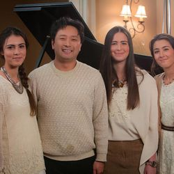 Masa Fukuda (second from left) stands with (left to right) Seli, Desi and Ari Miller.