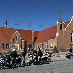 Officers wait outside Wasatch Presbyterian Church in Salt Lake City, Monday, March 9, 2015 during the memorial service for Deedee Corradini.