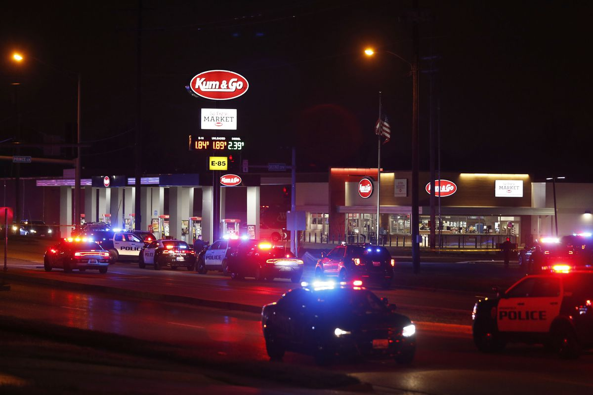 Police cars surround a Kum & Go gas station on East Chestnut Expressway in Springfield, Mo., after a shooting that left five people dead, including the gunman and a police officer, late Sunday, March 15, 2020.