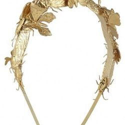 """<a href=""""http://www.vogue.com/guides/holiday-gift-guide-gifts-for-500-and-under/"""">Eugenia Kim headband</a>, $388. Undeniably gorgeous, but paying that much cash money to have Uncle Ed tell you that there's a bug in your hair before laughing hysterically a"""