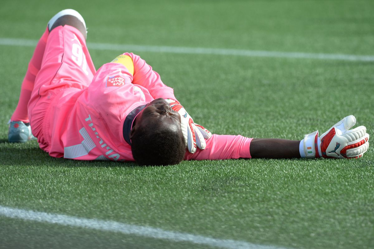 Yup, that one was painful - Ivory Coast keeper, nurses her sore shoulder after facing a German barrage