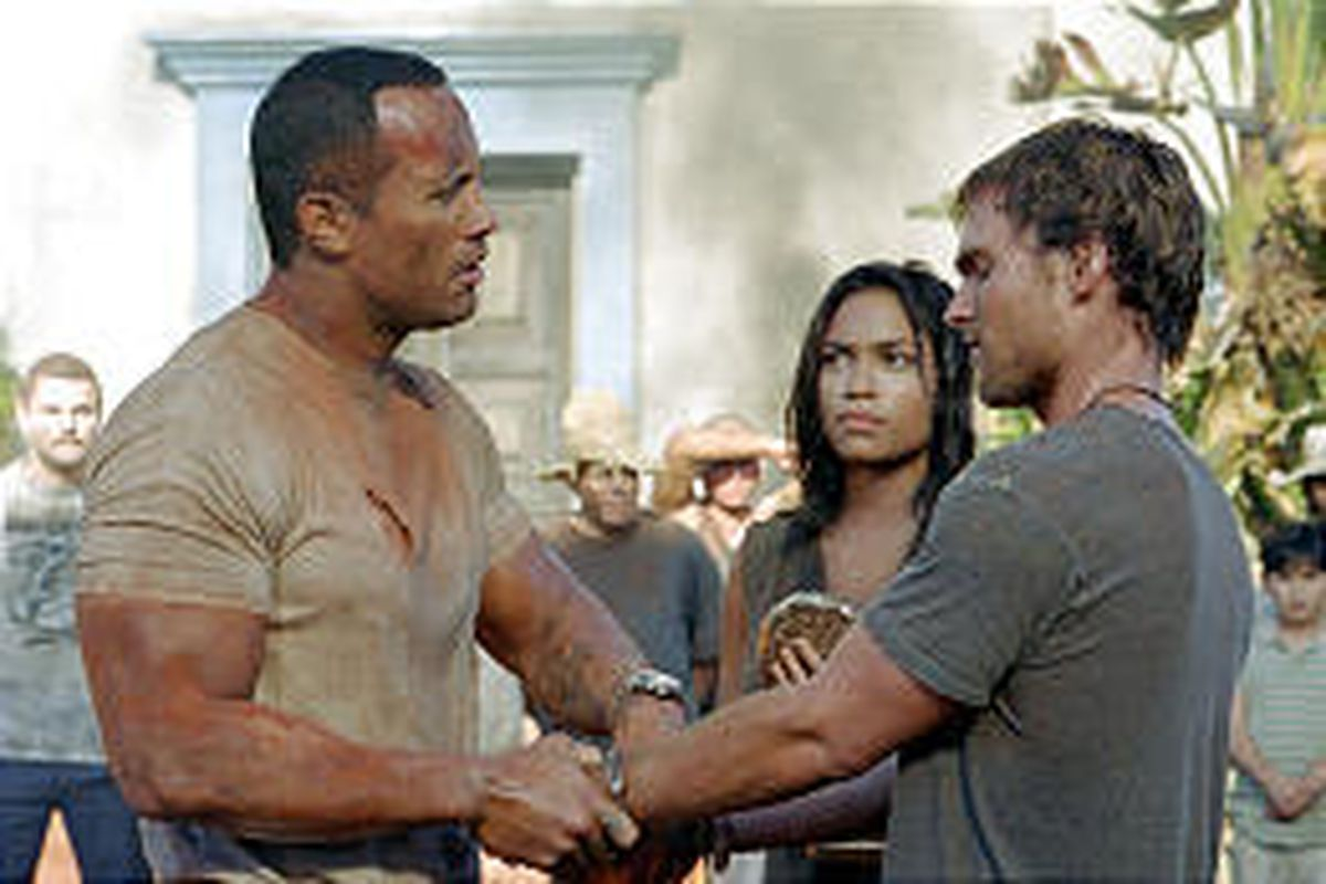 """Dwayne Johnson - better known as The Rock - Rosario Dawson and Seann William Scott star in the action-adventure """"The Rundown,"""" which is being screened at Salt Lake-area theaters Saturday."""