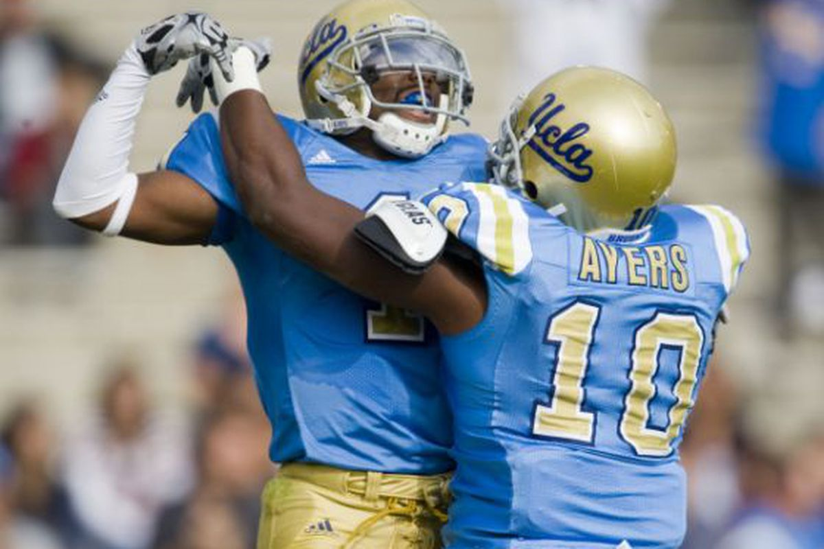 UCLA cornerback Alterraun Verner celebrates with linebacker Akeem Ayers (10) in the endzone after Verner intercepted an Arizona St. pass and returned 68 yards for a UCLA touchdown. (PAUL RODRIGUEZ, THE ORANGE COUNTY REGISTER)
