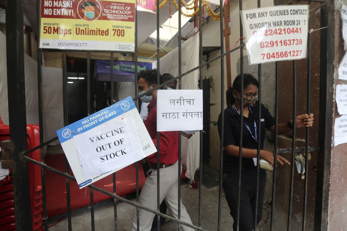 A sign announcing a shortage of COVID-19 vaccine hangs on the gate of a vaccination center in Mumbai, India on April 8, 2021. India is leading an effort to waive vaccine patent protections so more countries can manufacture the vaccine themselves.