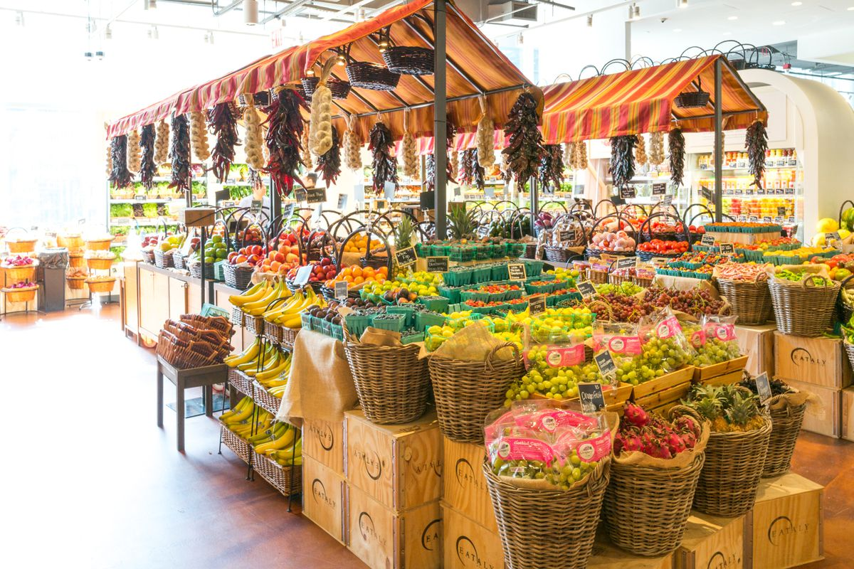 The interior of the Eataly market in Downtown New York City, featuring baskets of fruit and vegetables
