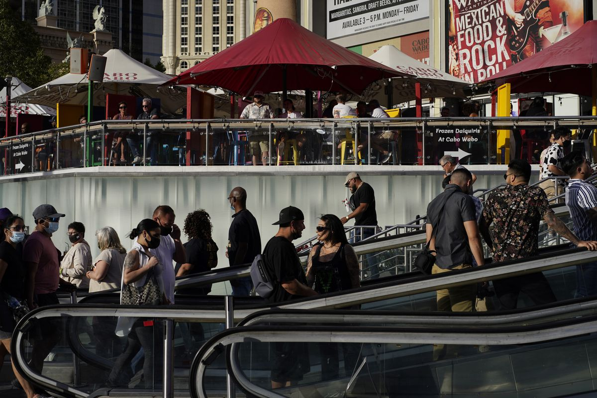 People walk as others dine on the Las Vegas Strip.