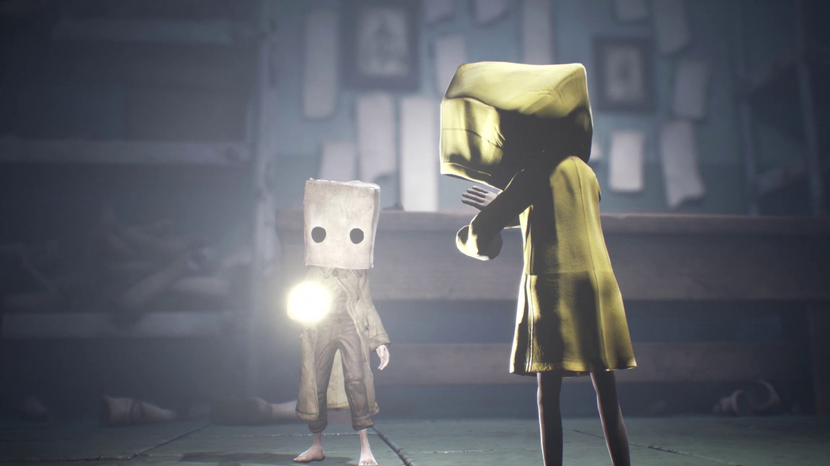 Mono shines a flashlight at Six in Little Nightmares 2