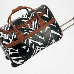 """<a href=""""http://www.dvf.com/Camargue-Collection-Wheeled-Duffel/1745C09,default,pd.html?dwvar_1745C09_color=BLACK&start=8&preselectsize=yes&cgid=luggage-accessories""""> Diane von Furstenberg Camargue Collection weekend duffle</a>, $200 dvf.com"""