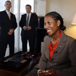 Mia Love, 4th District congressional candidate, who will be speaking at the Republican National Convention takes time out of practicing her speech to talk with local media in her hotel room in Tampa, Florida.  Her husband, Jason, at left, and Boyd Matheson, who is helping with the Love campaign, listen from behind.  Monday, Aug. 27, 2012