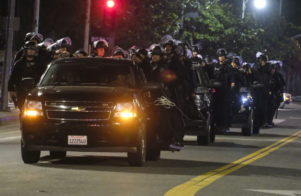 LAPD riot police stand by outside City Hall during a protest of the death of George Floyd, a black man who was in police custody in Minneapolis, in downtown Los Angeles, Wednesday, May 27, 2020. (AP Photo/Ringo H.W. Chiu)