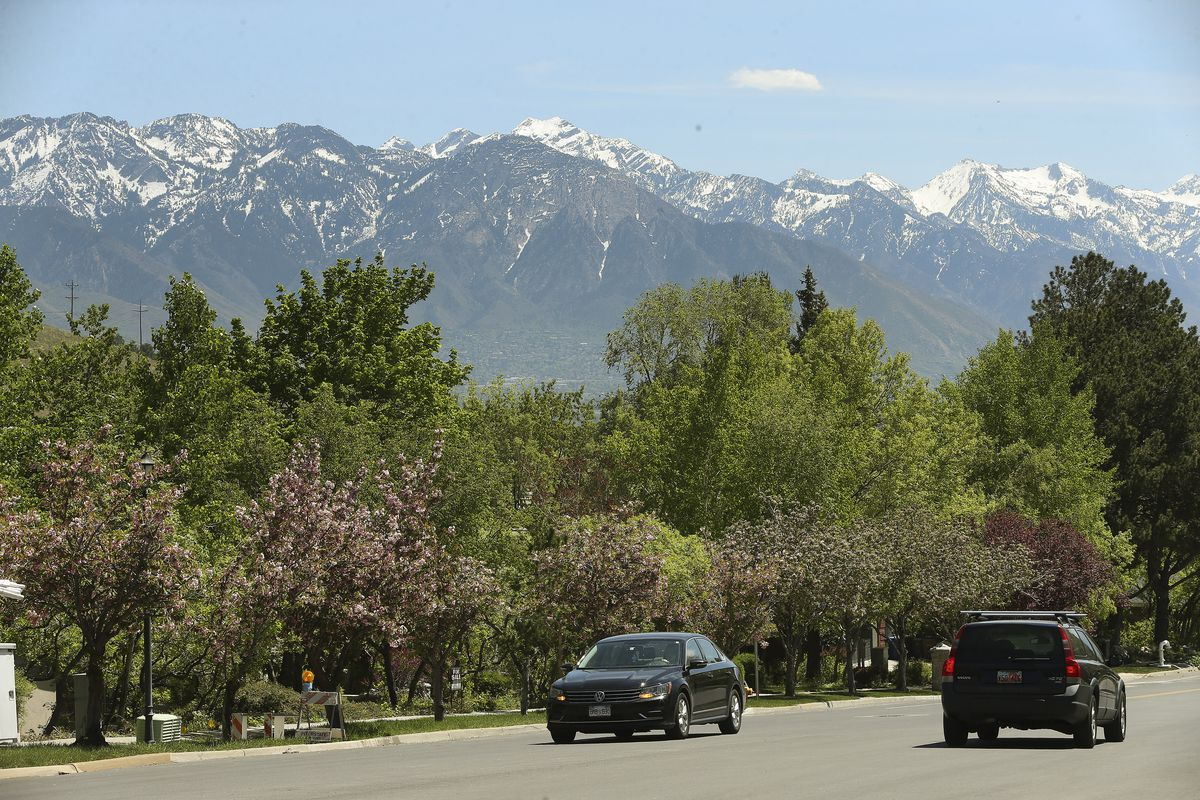 Motorists in Salt Lake City drive with a view of the Wasatch Mountains on Tuesday, May 5, 2020. A new analysis shows the coronavirus shutdown of schools and businesses dramatically reduced pollutants that form ugly haze and threaten public health.