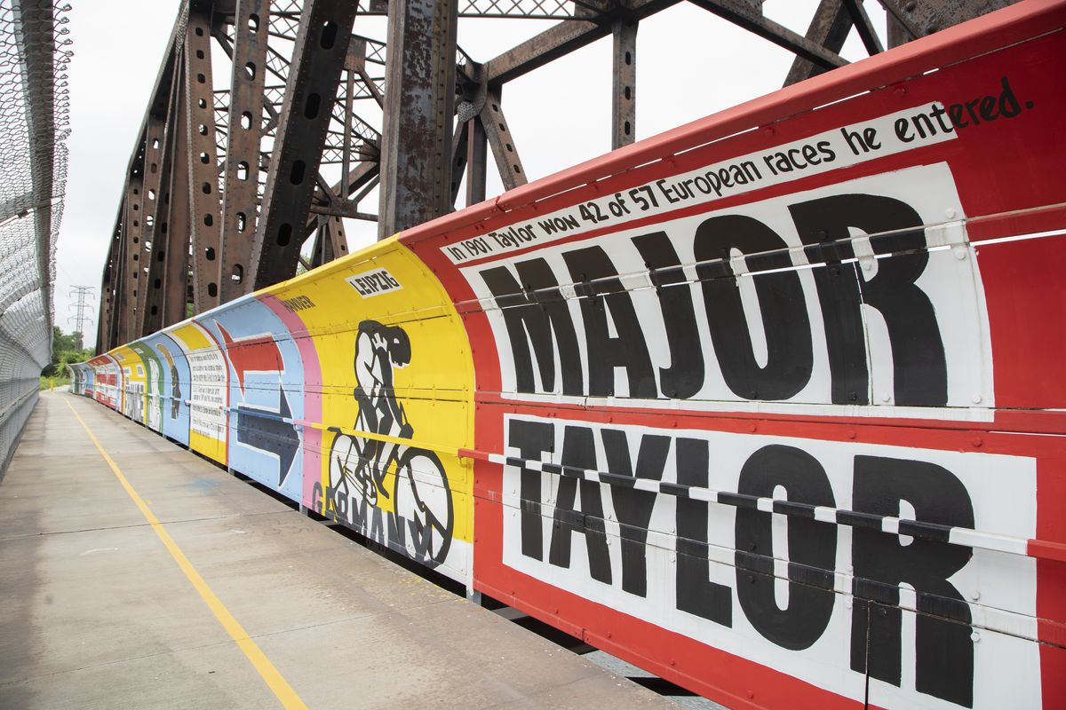 The Major Taylor Trail Mural, a series of paintings stretching 400 feet on a pedestrian bridge over the Little Calumet River, was done by Chicago artist Bernard Williams.