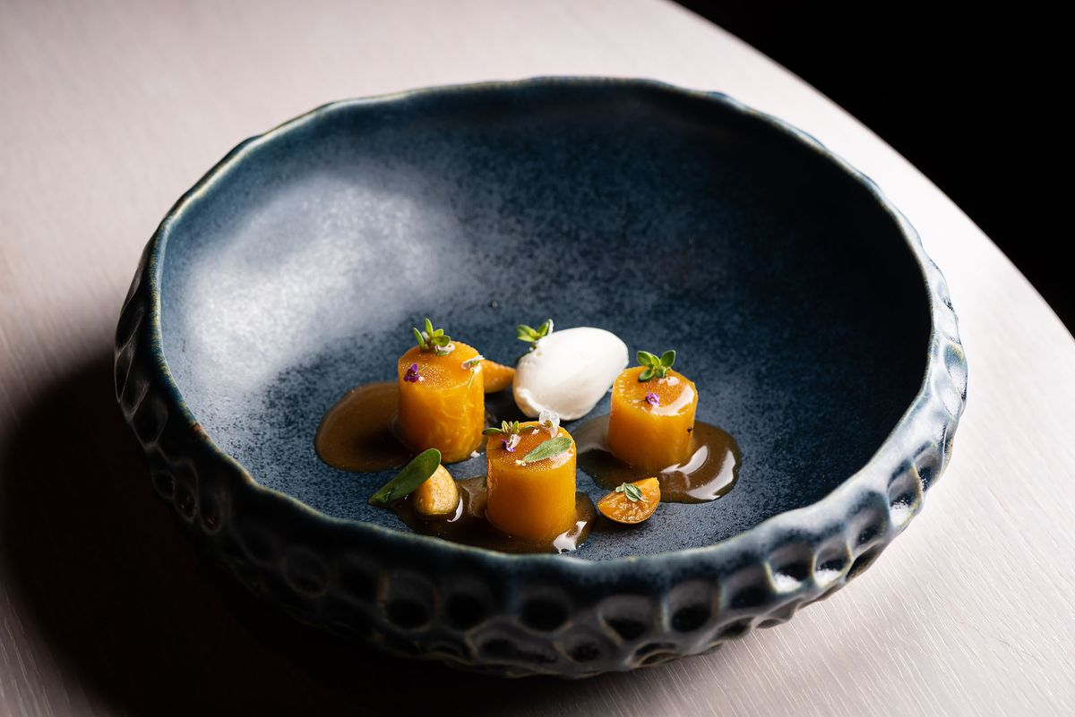 Golden beet cylinders at Melisse, a fine dining restaurant, in a shell bowl.