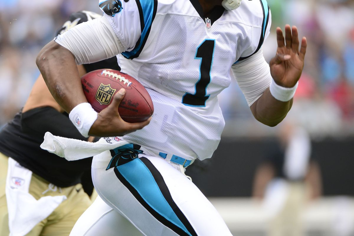 Sep 16, 2012; Charlotte, NC, USA; Carolina Panthers quarterback Cam Newton (1) breaks free for a long run in the first quarter. The Panthers defeated the Saints 35-27 at Bank of America Stadium . Bob Donnan-US PRESSWIRE