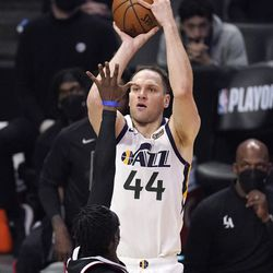 Utah Jazz forward Bojan Bogdanovic, top, shoots as Los Angeles Clippers guard Reggie Jackson defends during the second half of Game 3 of a second-round NBA basketball playoff series Saturday, June 12, 2021, in Los Angeles.