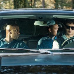 """Baby (Ansel Elgort, front right), Bats (Jamie Foxx, front left), JD (Lanny Joon, back right), Eddie (Flea Balzary, back left) wait in the car in """"Baby Driver."""""""