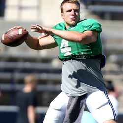 BYU football QB Taysom Hill practices throwing before a scrimmage at BYU in Provo on Saturday, Aug. 15, 2015.