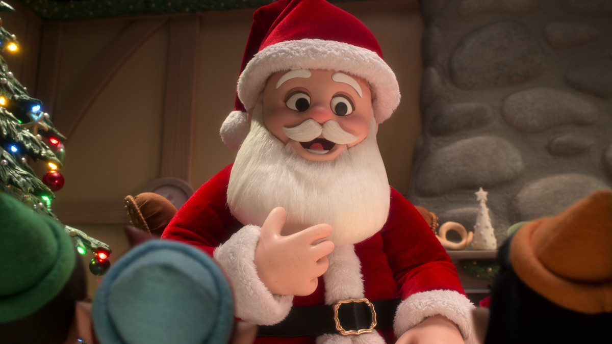 A stop-motion Santa Claus tells an audience of child elves a story in Alien Xmas