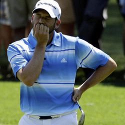 Sergio Garcia, of Spain, reacts after second shot on the third hole during the third round of the Masters golf tournament Saturday, April 7, 2012, in Augusta, Ga.