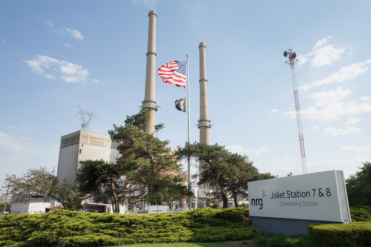 An American flag hangs in front of NRG Energy's Joliet Station power plant on May 7, 2015 in Joliet, Illinois.