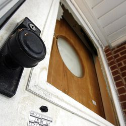 Bullet holes marked in the front door of the home at 3268 Jackson Avenue in Ogden, Tuesday, Jan. 10, 2012.