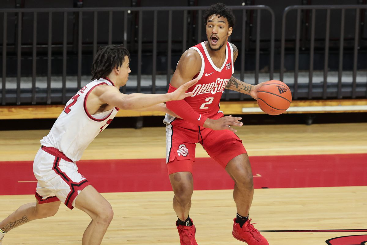 Ohio State Buckeyes guard Musa Jallow (2) dribbles as Rutgers Scarlet Knights guard Caleb McConnell (22) defends during the second half at Rutgers Athletic Center (RAC).