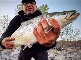 Jesus Arellano with a nice lakefront brown trout. Provided photo
