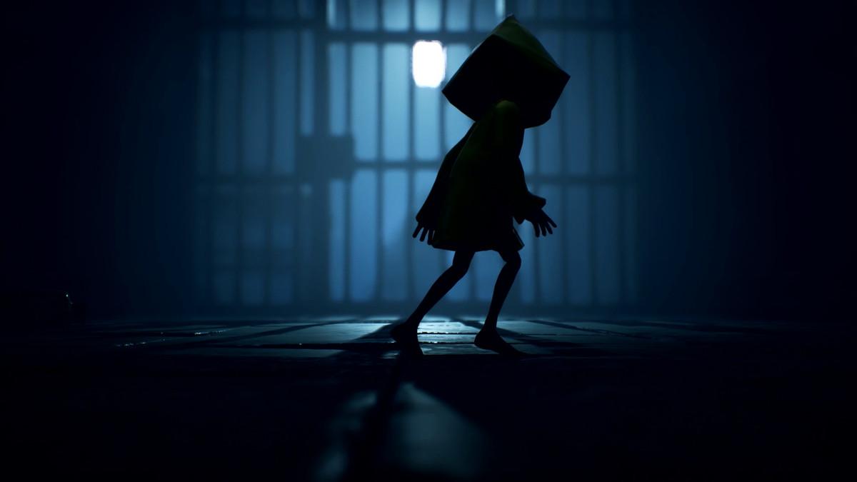 Six sneaks by a barred door in Little Nightmares 2