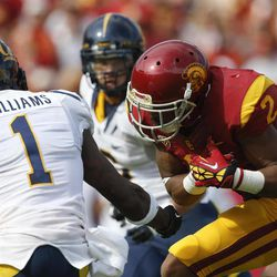 California defensive back Steve Williams, left, breaks up a pass intended  for Southern California wide receiver Robert Woods during the first half of an NCAA college football game in Los Angeles, Saturday, Sept. 22, 2012.