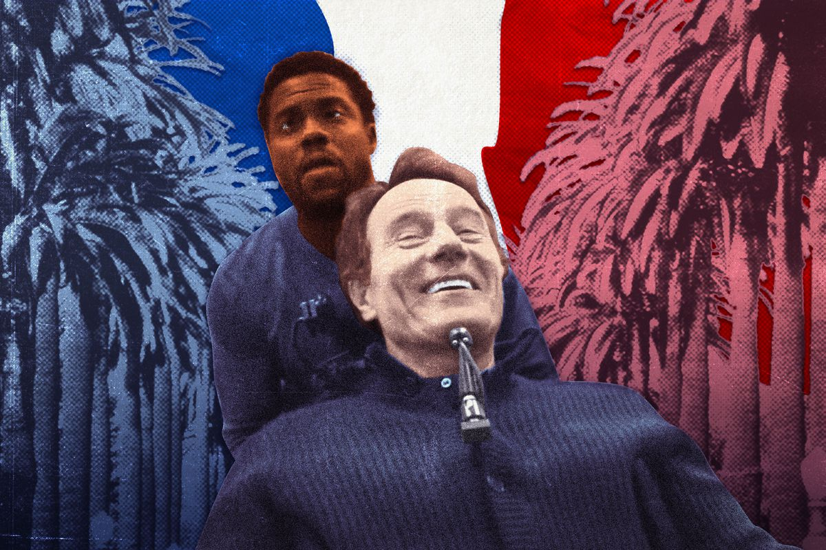 A black man and a white man in front of a backdrop of palm trees and the French flag