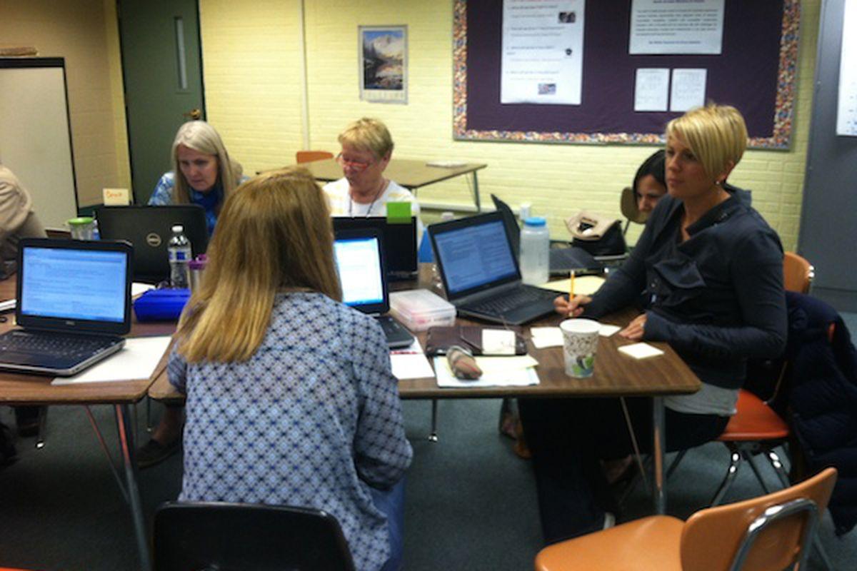 The language arts team works through planning next year's curriculum.