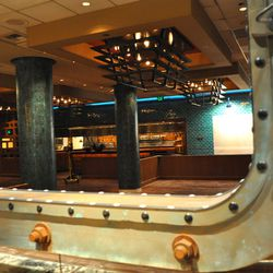 Port holes from actual ships separate the bar from the dining room.