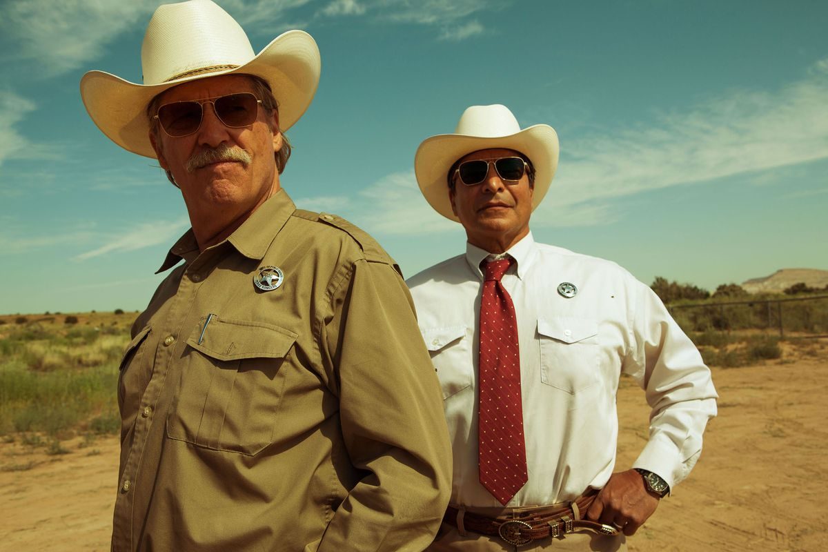 The two Texas Rangers survey the land.