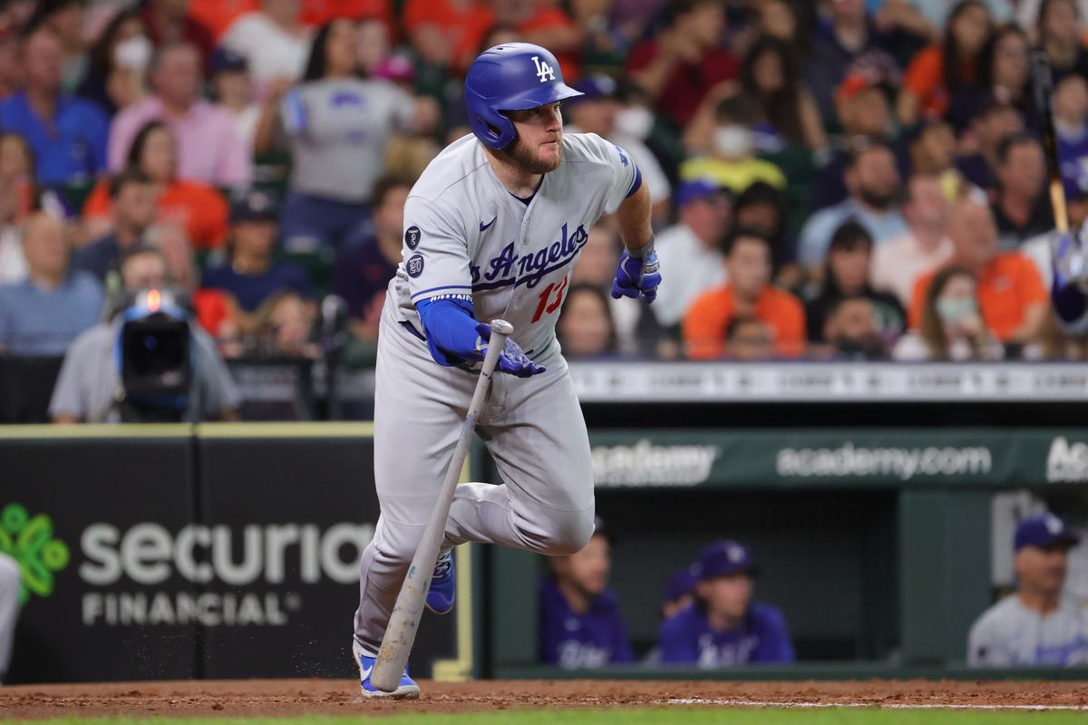 Max Muncy #13 of the Los Angeles Dodgers hits an RBI single during the third inning against the Houston Astros at Minute Maid Park on May 26, 2021 in Houston, Texas.