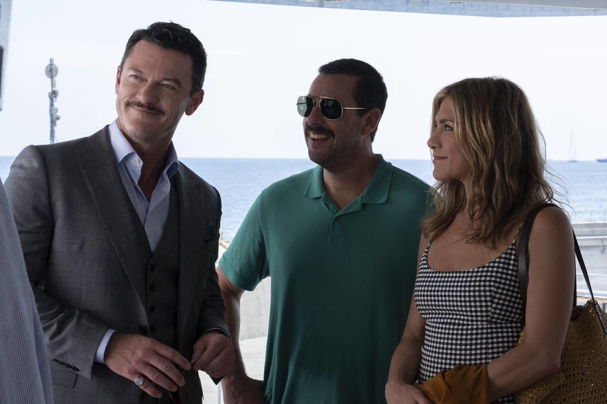 "Luke Evans, Adam Sandler, and Jennifer Aniston in ""Murder Mystery"" on Netflix."