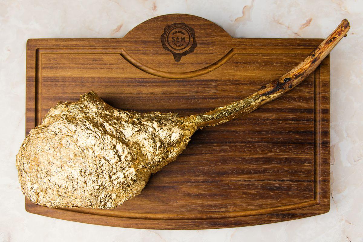 Gold-leaf foil-encrusted ribeye from Steak Market in Atlanta