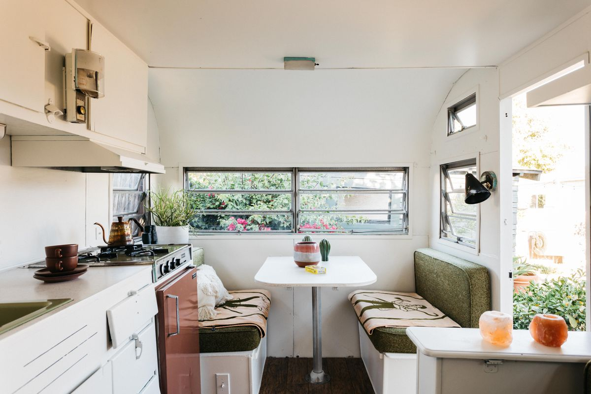Seating area with a small table in a trailer.