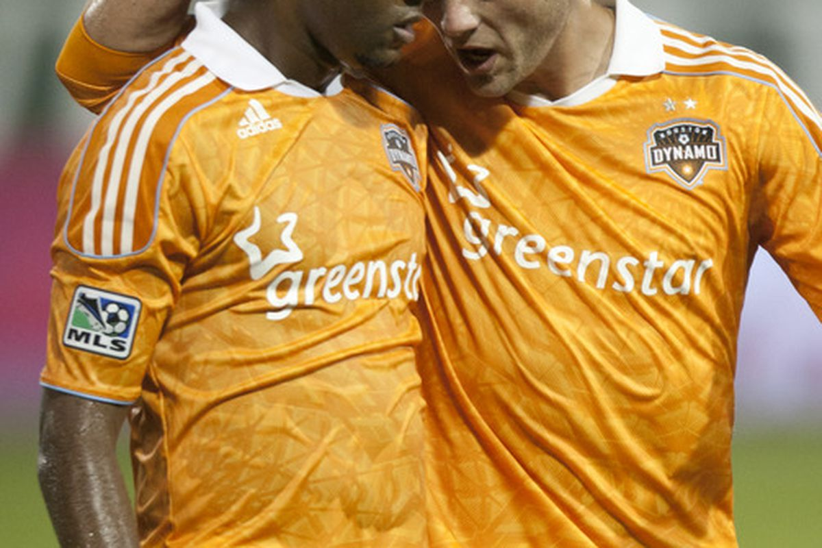 PORTLAND, OR - OCTOBER 14:  Luiz Camargo and Brad Davis #11 of the Houston Dynamo celebrate a win against the Portland Timbers at Jeld-Wen Field on October 14, 2011 in Portland Oregon. (Photo by Jay Drowns/Getty Images)