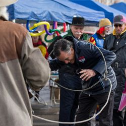 """FILE""""""""Lannie Scopes, left, lassos Mitt Romney at the 2002 Winter Olympics 15th Anniversary Community Festival at Soldier Hollow in Midway on Saturday, Feb. 04, 2017."""
